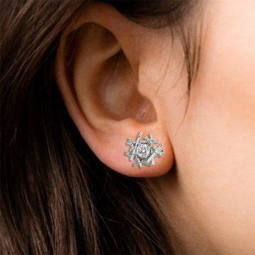 Platinum sticks and stones earring on ear